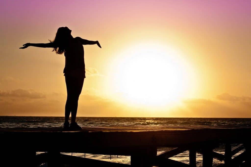 happy woman on boardwalk