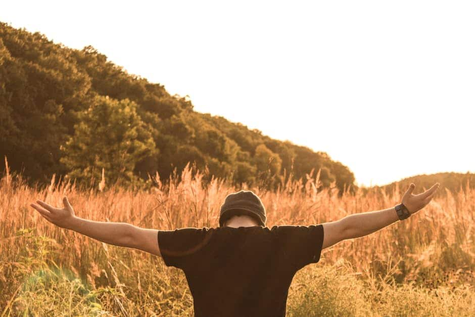 man embracing life with open arms